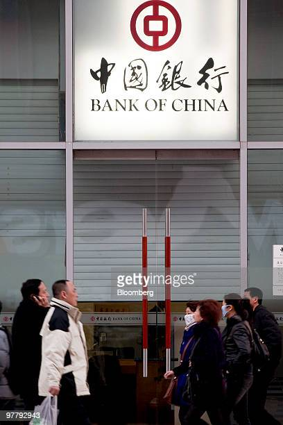 Pedestrians walk past a branch of the Bank of China Ltd in Beijing China on Monday March 15 2010 Bank of China Ltd is nearing a $7 billion share...