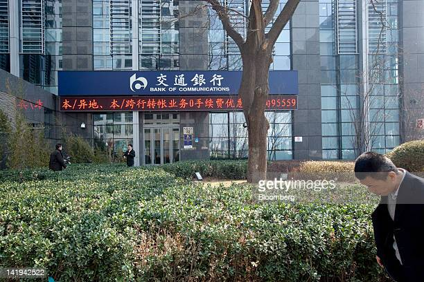 Pedestrians walk past a branch of the Bank of Communications Co Ltd in Beijing China on Tuesday March 27 2012 Bank of Communications is expected to...