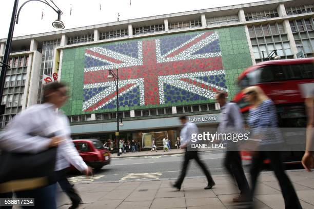 Pedestrians walk past a British Union flag design decorating a John Lewis store front in Oxford Street in central London on June 8 as Britain...