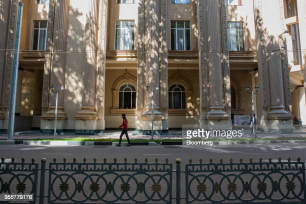 Pedestrians walk past a building on Rudaki Avenue in Dushanbe Tajikistan on Saturday April 21 2018 Flung into independence after the Soviet Union...