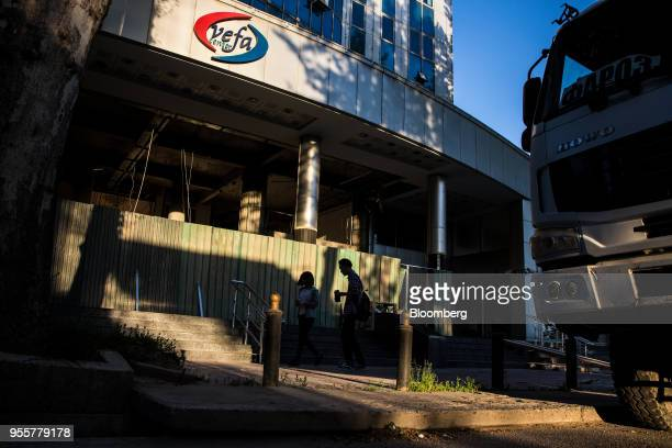 Pedestrians walk past a building under construction in Dushanbe Tajikistan on Saturday April 21 2018 Flung into independence after the Soviet Union...
