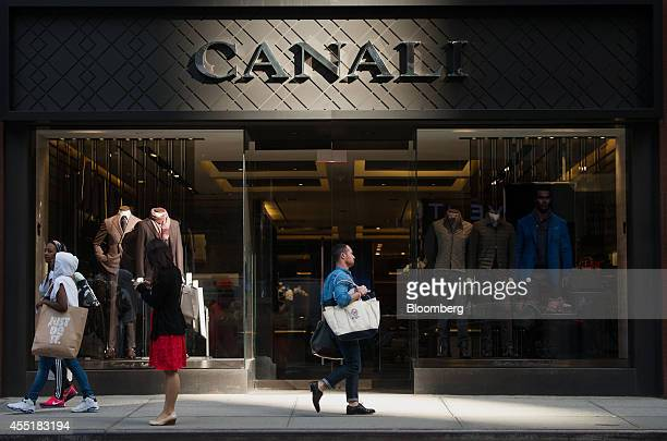 Pedestrians walk past a Canali SpA store on Madison Avenue in New York US on Wednesday Sept 3 2014 The Bloomberg Consumer Comfort Index a survey...