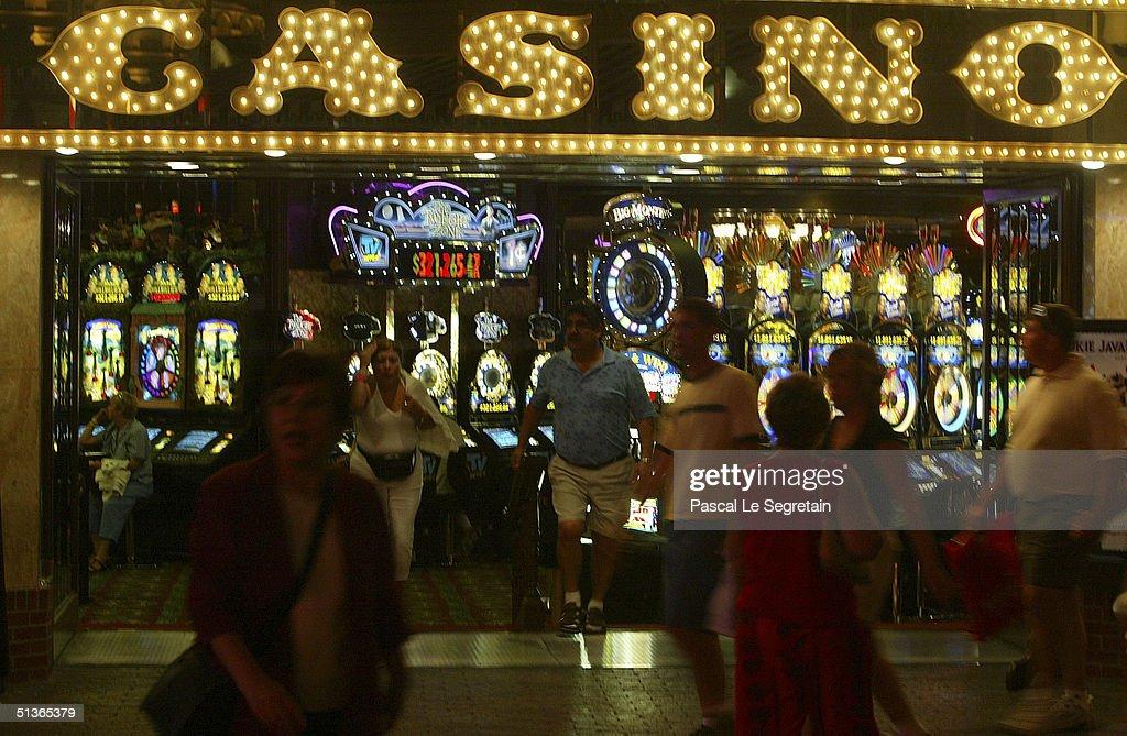 Pedestrians walk past a Casino at night on Las Vegas Boulevard on September 17 in Las Vegas.
