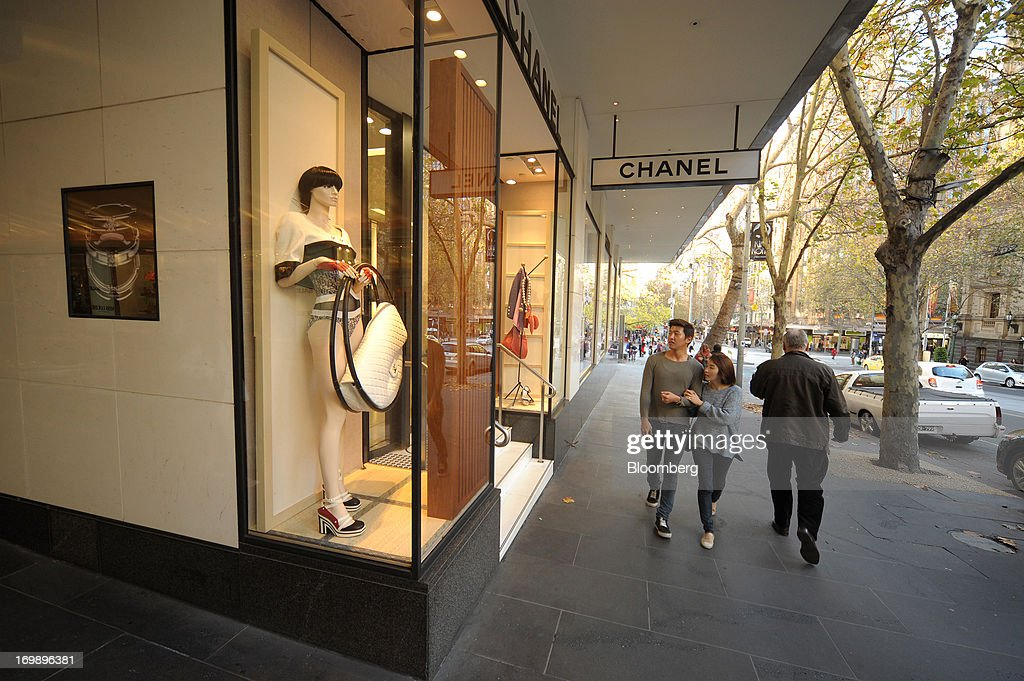 Pedestrians walk past a Chanel store in central Melbourne, Australia, on Sunday, June 2, 2013. The Australian Bureau of Statistics is scheduled to release first-quarter gross domestic product data on June 5. Photographer: Carla Gottgens/Bloomberg via Getty Images