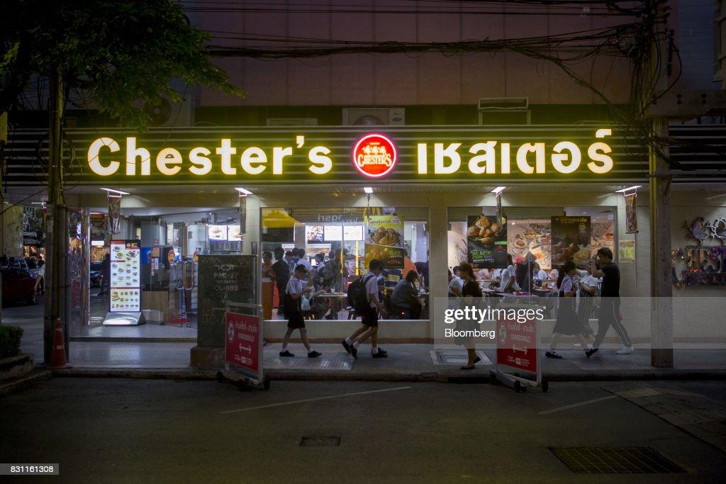 Pedestrians walk past a Chester's Grill restaurant in