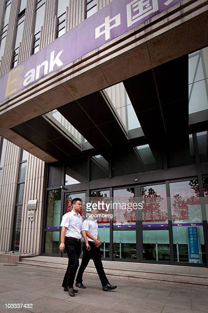 Pedestrians walk past a China Everbright Bank Co branch in Beijing China on Wednesday Aug 11 2010 China Everbright Bank Co may raise as much as 1891...