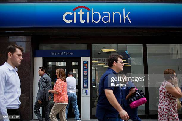 Pedestrians walk past a Citigroup Inc Citibank branch in New York US on Thursday July 10 2014 Citigroup is expected to release earnings on Monday...