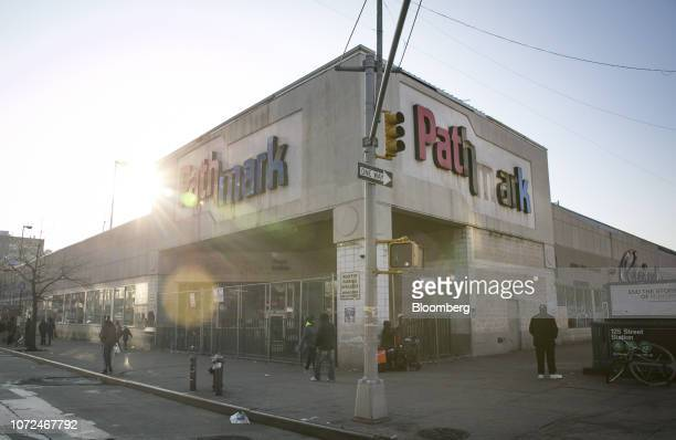 Pedestrians walk past a closed Pathmark Stores Inc. Supermarket in the East Harlem neighborhood of New York, U.S., on Wednesday, Dec. 12, 2018. While...