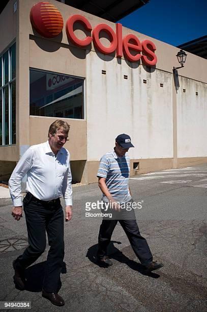 Pedestrians walk past a Coles Group Ltd supermarket in Perth Australia on Thursday Jan 22 2009 Wesfarmers Ltd Australia's second largest retailer...