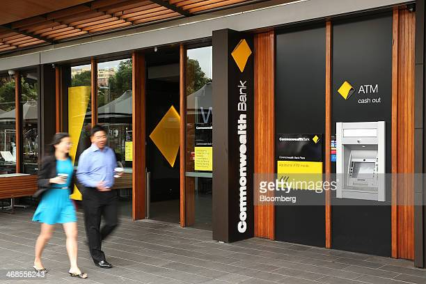 Pedestrians walk past a Commonwealth Bank of Australia branch in Sydney Australia on Monday Feb 10 2014 Commonwealth Bank Australia's largest lender...