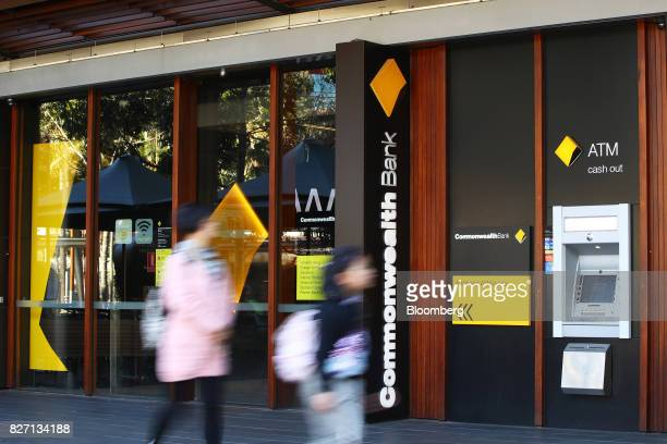 Pedestrians walk past a Commonwealth Bank of Australia branch in Sydney Australia on Monday Aug 7 2017 Commonwealth Bank has blamed a software coding...