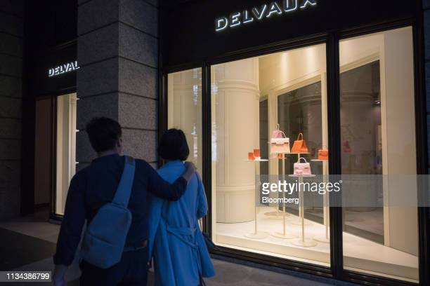 Pedestrians walk past a Delvaux Createur SA store at the Bellavita luxury mall in Taipei Taiwan on Saturday March 30 2019 According to Knight Frank's...