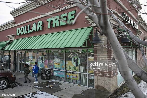 Pedestrians walk past a Dollar Tree Inc store in Detroit Michigan US on Saturday Feb 27 2016 Dollar Tree Inc is scheduled to release earnings figures...