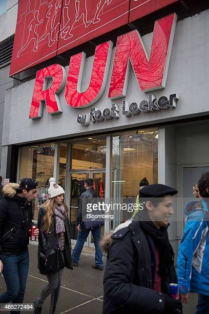 Pedestrians walk past a Foot Locker Inc Run store in New York US on Wednesday March 4 2015 Foot Locker Inc is scheduled to release earnings figures...