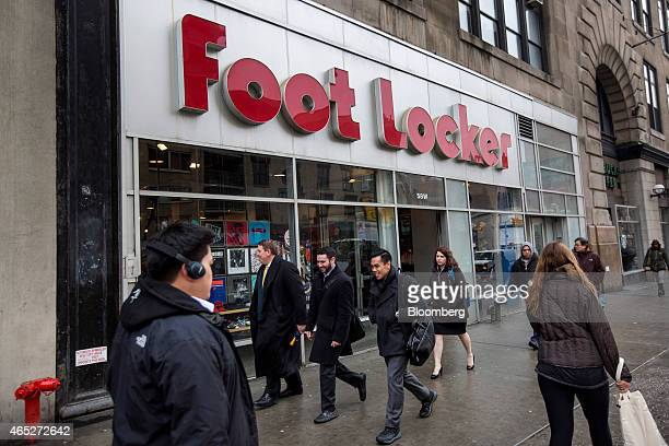 Pedestrians walk past a Foot Locker Inc store in New York US on Wednesday March 4 2015 Foot Locker Inc is scheduled to release earnings figures on...