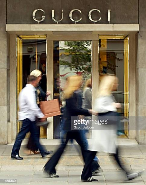 Pedestrians walk past a Gucci store September 27, 2002 in London, England. Italian fashion store Gucci Group warned September 26, 2002 that it may...