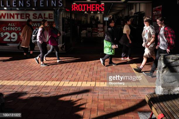 Pedestrians walk past a Hallenstein Brothers Ltd store in Wellington New Zealand on Wednesday July 18 2018 New Zealand inflation picked up in the...