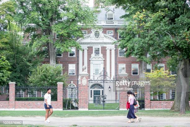 Pedestrians walk past a Harvard University building on August 30 2018 in Cambridge Massachusetts The US Justice Department sided with AsianAmericans...