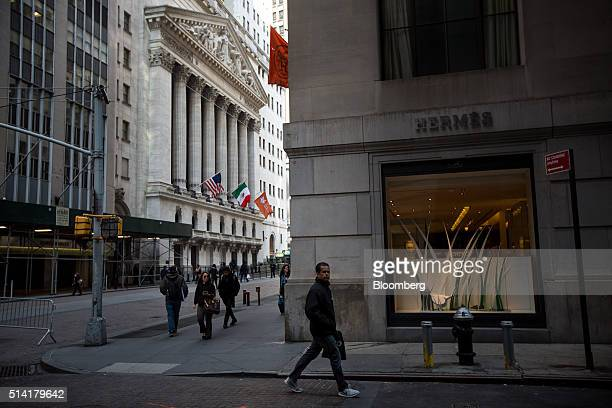 Pedestrians walk past a Hermes International store near the New York Stock Exchange in New York US on Monday March 7 2016 US stocks fluctuated near...