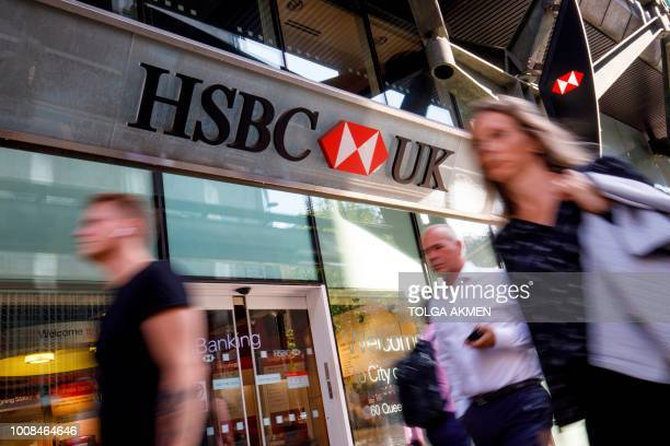 Pedestrians walk past a HSBC UK bank branch in central London on July 31 2018 HSBC will publish their halfyear results on August 6