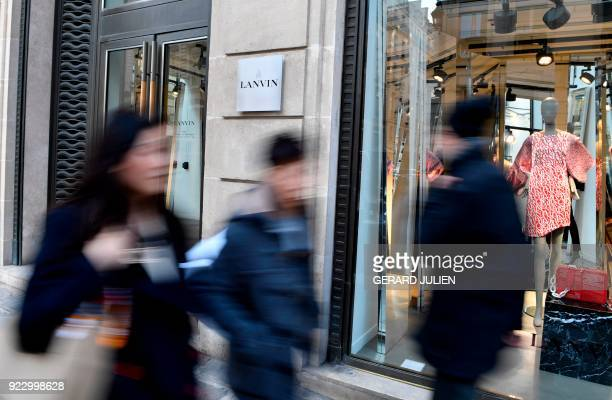 Pedestrians walk past a Lanvin shop on the Rue du Faubourg SaintHonore in Paris on February 22 2018 Chinese conglomerate Fosun has snapped up the...