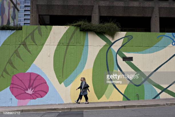 Pedestrians walk past a mural in the Crystal City area of Arlington Virginia US on Wednesday Nov 7 2018 Seattlebased Amazon Inc is close to...