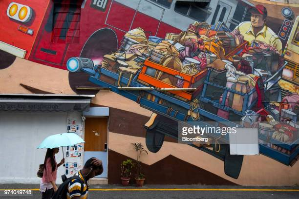 Pedestrians walk past a mural in the Little India area of Singapore on Wednesday June 13 2018 Tourism as well as the consumer sector will likely see...