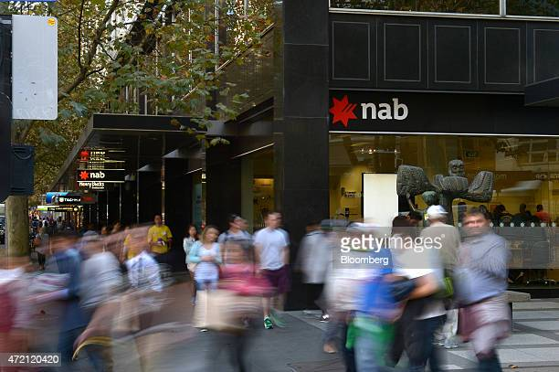 Pedestrians walk past a National Australia Bank Ltd branch in Melbourne Australia on Friday May 1 2015 NAB is scheduled to report interim results on...