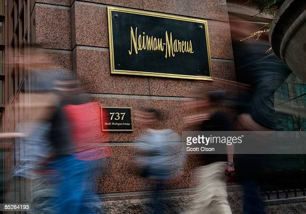 Pedestrians walk past a Neiman Marcus store on the Magnificent Mile March 5 2009 in Chicago Illinois Neiman Marcus Group Inc which operates Neiman...
