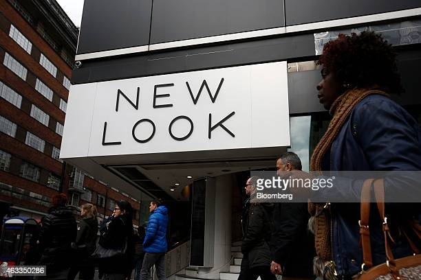 Pedestrians walk past a New Look fashion store operated by New Look Group Ltd on Oxford Street in London UK on Friday Feb 13 2015 Apax Partners and...