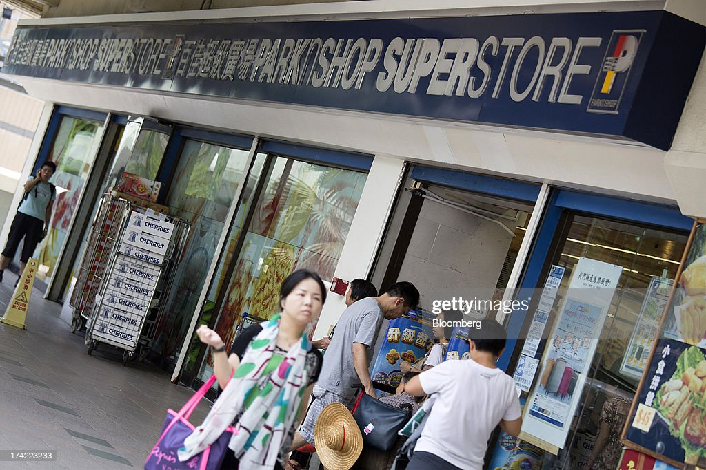 Pedestrians walk past a ParknShop superstore supermarket, operated by Hutchison Whampoa Ltd., in Hong Kong, China, on Monday, July 22, 2013. Billionaire Li Ka-shing's biggest company may exit one of the two largest supermarket operations in Hong Kong as it seeks to grow other businesses. Photographer: Jerome Favre/Bloomberg via Getty Images