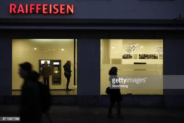 Pedestrians walk past a Raiffeisen Schweiz Genossenschaft bank branch in Bern Switzerland on Tuesday Nov 7 2017 Switzerland's financial regulator has...