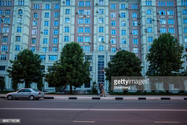 Pedestrians walk past a residential building in Dushanbe Tajikistan on Sunday April 22 2018 Flung into independence after the Soviet Union collapsed...