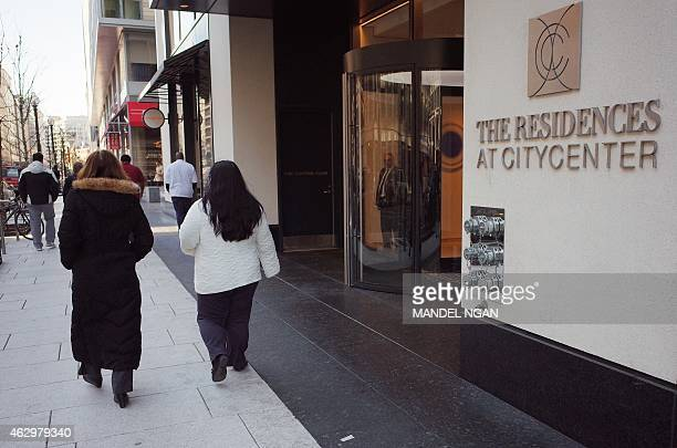 Pedestrians walk past a residential section of CityCenter DC an intergrated development in Washington DC on February 4 2015 The project contains a...