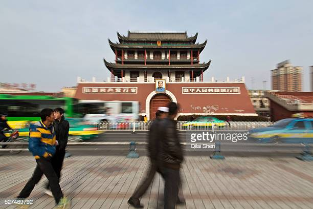 Pedestrians walk past a small replica of the Tiananmen gate in Yinchuan Ningxia Hui Autonomous Region China on 21 December 2012 With its dry climates...
