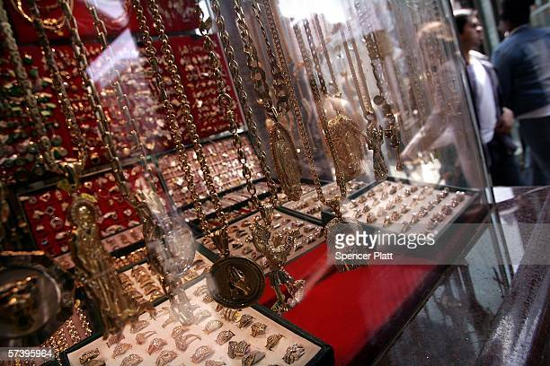 Pedestrians walk past a store displaying gold jewelry April 21 2006 in New York City The price of gold rose to $63260 a troy ounce Wednesday the...