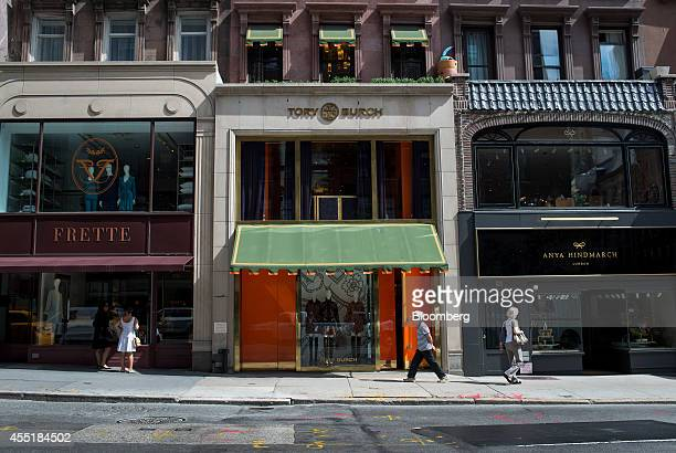 Pedestrians walk past a stores on Madison Avenue in New York US on Wednesday Sept 3 2014 The Bloomberg Consumer Comfort Index a survey which measures...