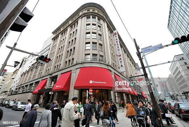 Pedestrians walk past a Takashimaya Co department store in the Nihonbashi district of Tokyo Japan on Friday Apr 9 2010 Takashimaya Co reported...