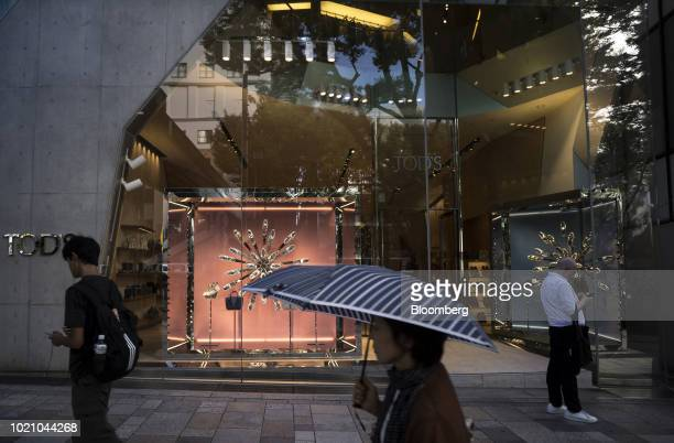 Pedestrians walk past a Tod's SpA store in the Omotesando area of Tokyo Japan on Tuesday Aug 21 2018 Japan is scheduled to release February's...