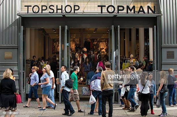 Pedestrians walk past a Topshop Topman store operated by Arcadia Group PLC, in the shopping district of Soho in New York, U.S., on Saturday, Sept....
