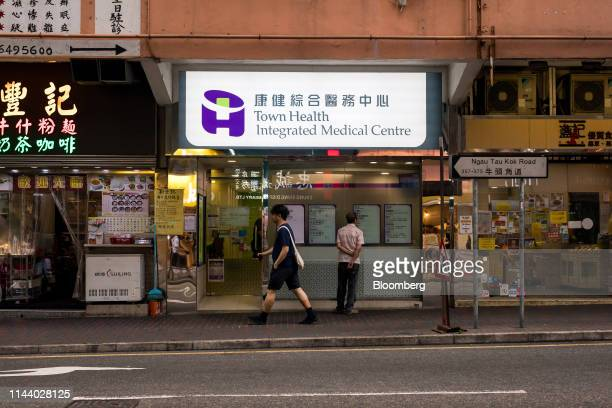 Pedestrians walk past a Town Health International Medical Group Ltd clinic in Hong Kong China on Monday May 13 2019 Cho Kwaichee founder of Town...