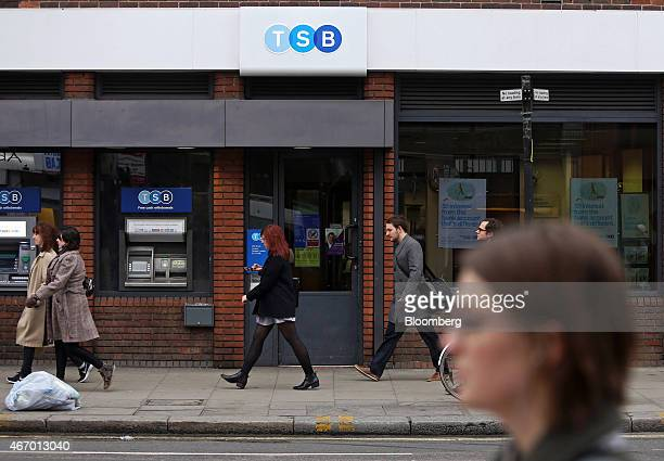Pedestrians walk past a TSB bank branch operated by TSB Banking Group Plc in London UK on Friday March 20 2015 Banco de Sabadell SA Spain's...