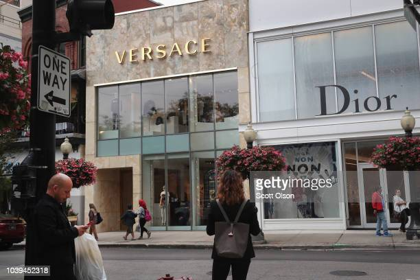 Merchandise is displayed in the front window of a Versace store on September 24 2018 in Chicago Illinois Michael Kors is reported to have purchased...