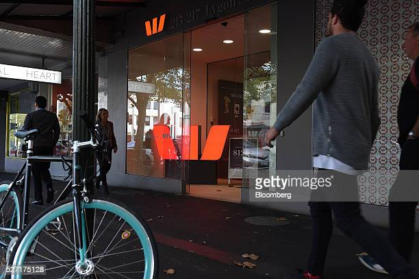 Pedestrians walk past a Westpac Banking Corp branch in Melbourne Australia on Monday May 2 2016 Westpac which increased provisions for soured loans...