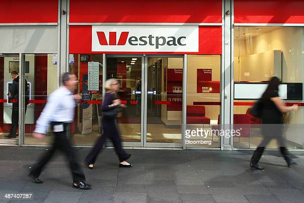 Pedestrians walk past a Westpac Banking Corp branch in Sydney Australia on Wednesday April 30 2014 Westpac the thirdbiggest issuer of bank debt in...