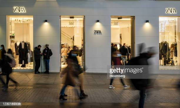 Pedestrians walk past a Zara clothing store, operated by Inditex SA, in Madrid, Spain, on Thursday, Dec. 17, 2020. The pandemic has been a stress...