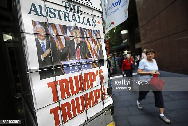 Pedestrians walk past an advertisement for the Australian newspaper featuring a picture of US Presidentelect Donald Trump displayed at a newspaper...