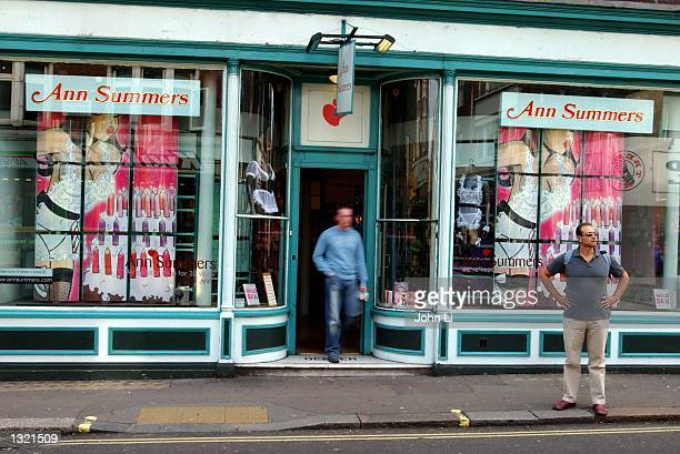 Pedestrians walk past an Ann Summers adult shop August 8 2002 in the Soho area of London England The Ann Summers chain of adult shops have steadily...