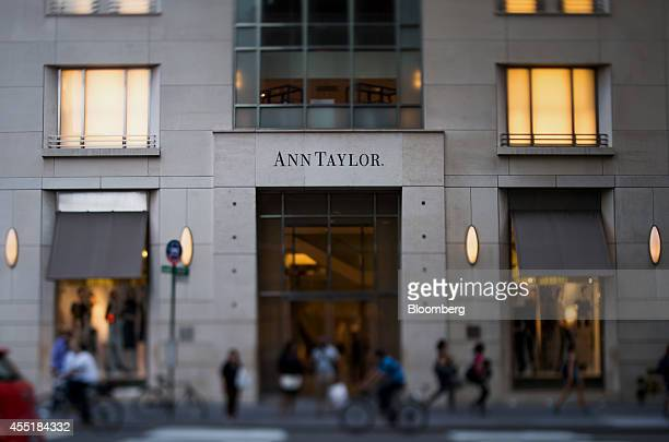 Pedestrians walk past an Ann Taylor Inc store in this photo taken with a tiltshift lens on Madison Avenue in New York US on Wednesday Sept 3 2014 The...