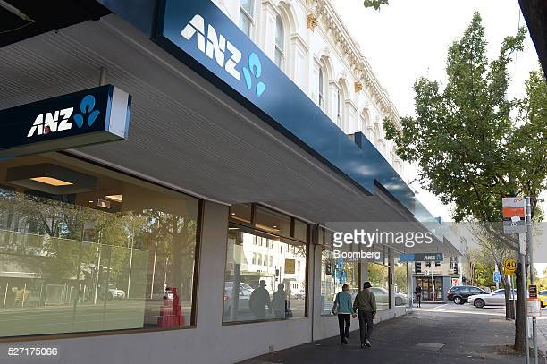 Pedestrians walk past an Australia New Zealand Banking Group Ltd branch in Melbourne Australia on Monday May 2 2016 ANZ is scheduled to report...
